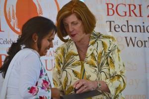 Dr. Chhavi Tiwari receives Women in Triticum award from Dr. Jeanie Borlaug Laube. Photo: Kat Coldren, BGRI